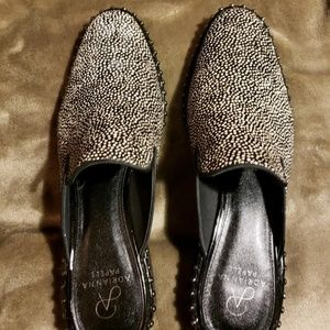 Black and white speckled leather mules